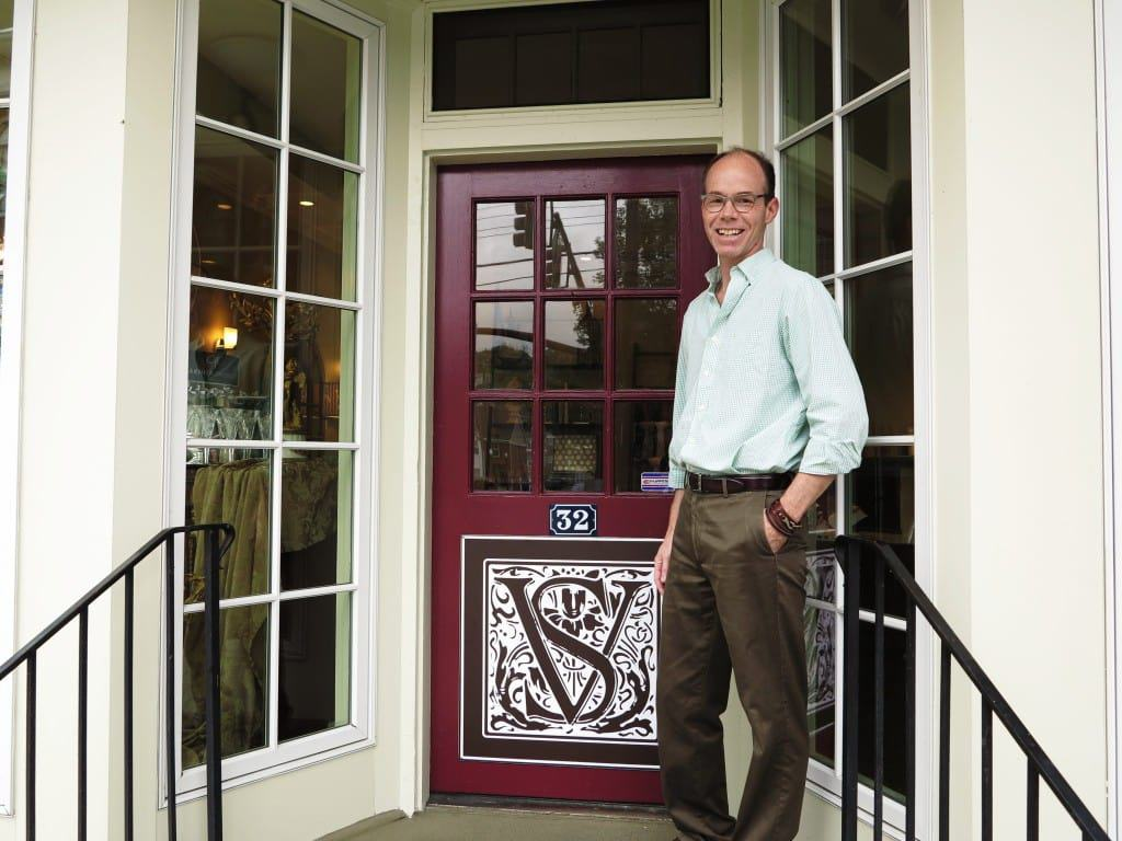 Brad Price standing in front of Villa Sanctuary entrance